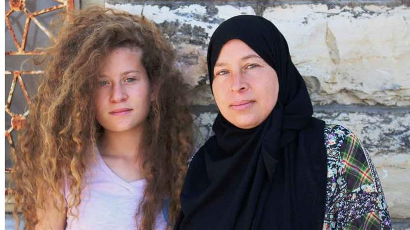 Palestinian activist Ahed with her mother Nariman [Al Jazeera]